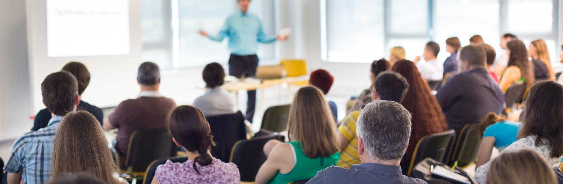 Speaker,At,Business,Convention,And,Presentation.,Audience,At,The,Conference